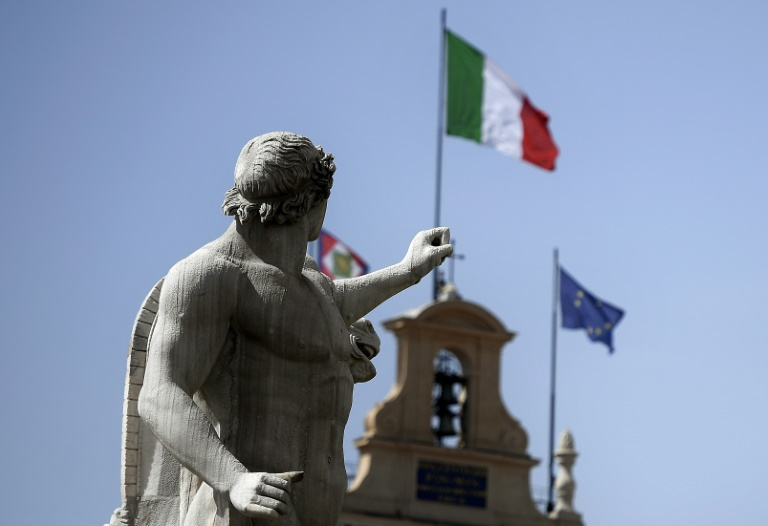S&P downgrades Italy debt outlook, raising pressure in budget stand-off