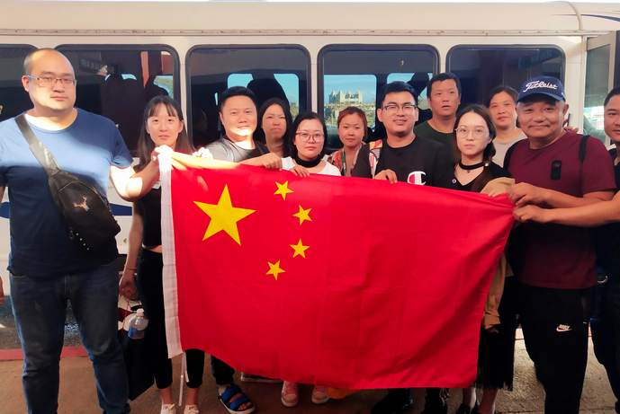 Tourists trapped by typhoon return to China from Saipan