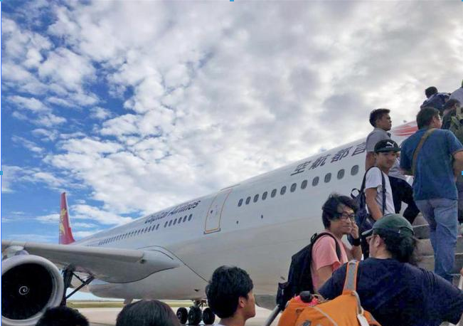 Another 261 Chinese tourists trapped in Saipan return to Beijing