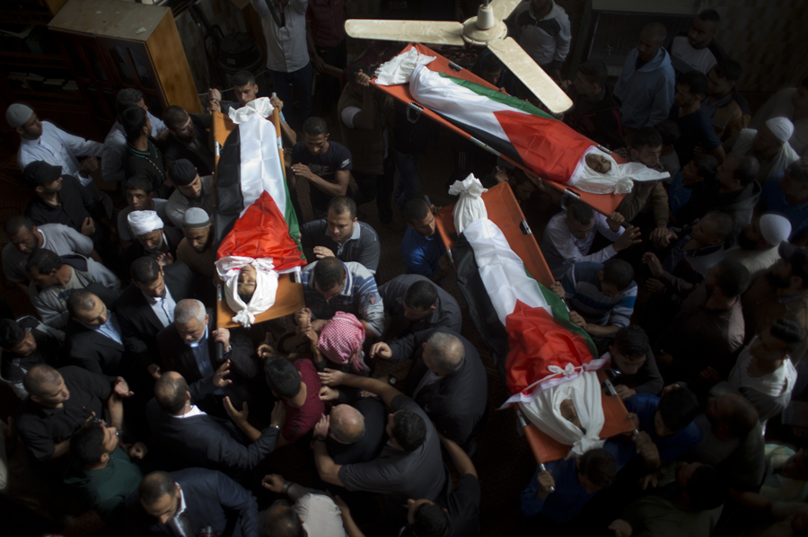 Thousands of outraged mourners bury 3 Palestinian children killed in Gaza