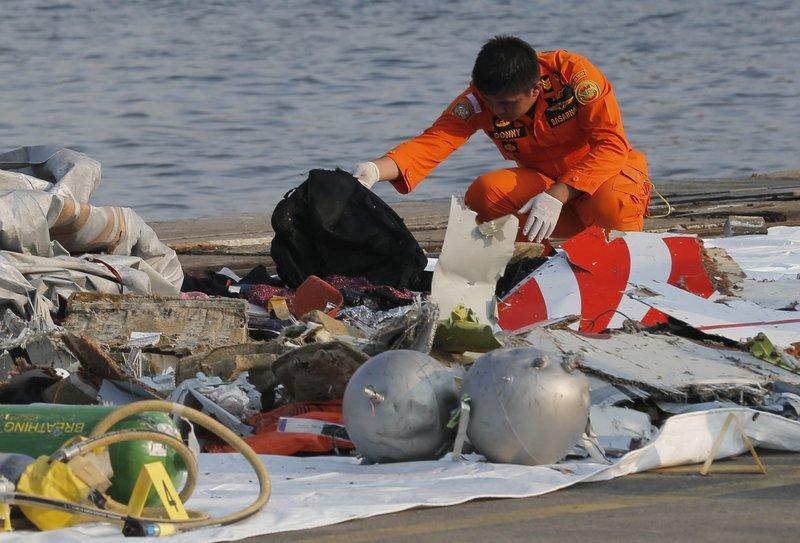 Indonesia plane crash search finds remains, debris at sea