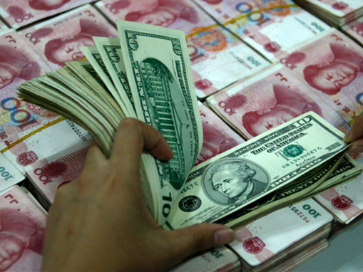 Chinese yuan weakens to 6.9574 against USD Tuesday