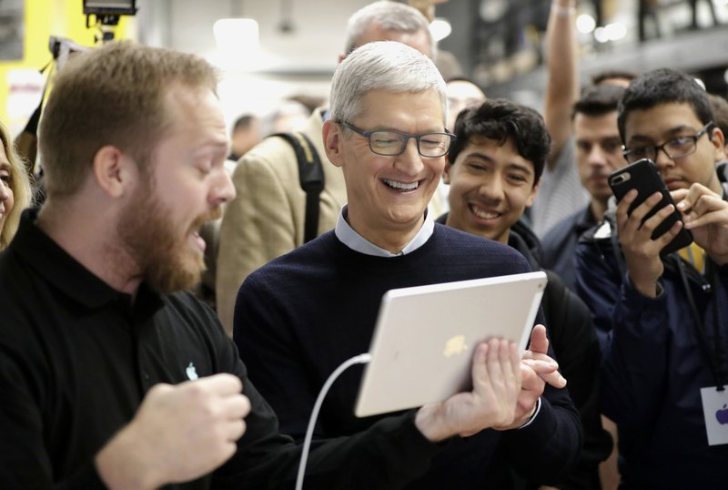 The Latest: New iPads embrace facial recognition