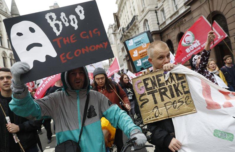 UK demonstrators press Uber ahead of key legal fight