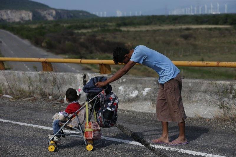 Weary migrant caravan rests in south Mexico, asks for buses
