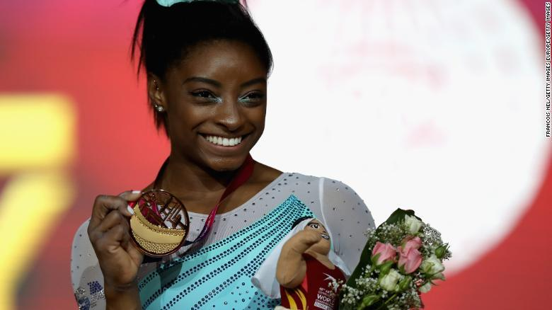 Biles wins record 13th world gold but denied clean sweep