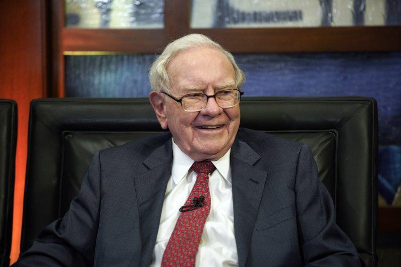 Buffett's firm quadruples 3Q profit on investment gains