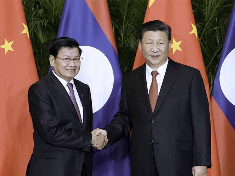 Xi meets Lao prime minister