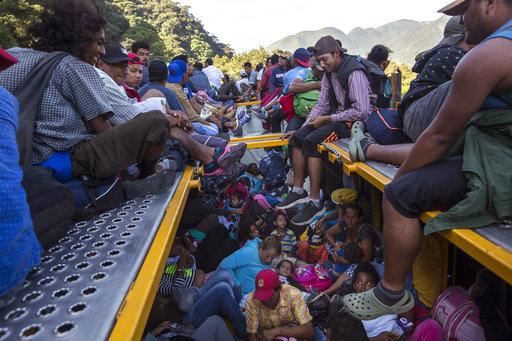 Caravan migrants arrive in Mexico City, bed down in stadium