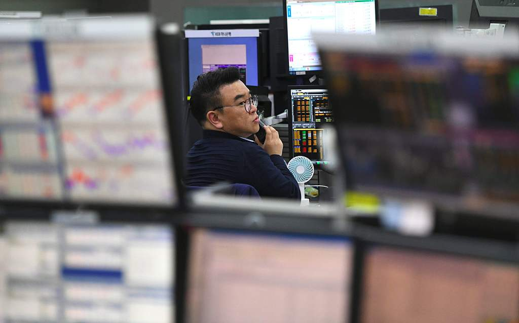 Asian markets mostly up as attention turns to US elections