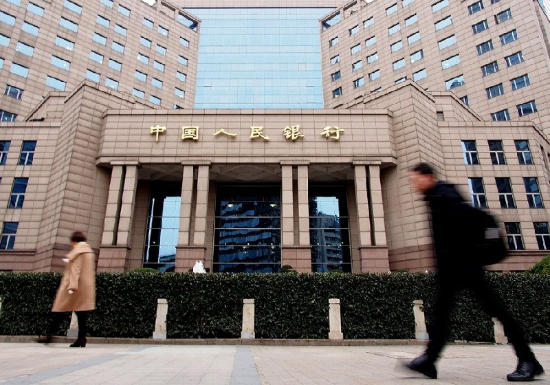 China's forex reserves edge down in October
