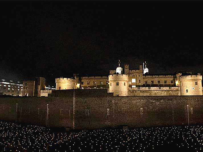 "People view ""Beyond the Deepening Shadow: The Tower Remembers"" at Tower of London"