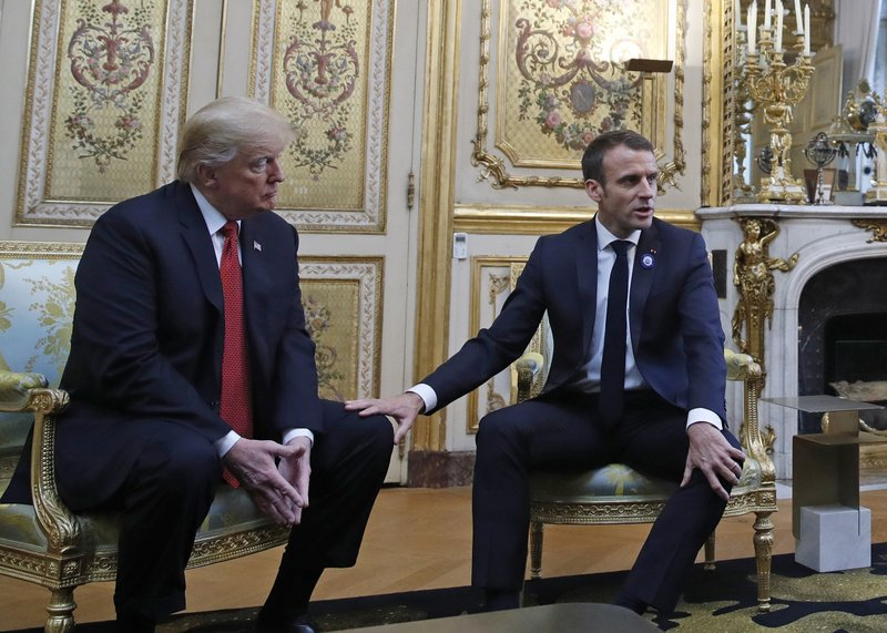 Tapping Trump's thigh, Macron seeks to defuse tensions