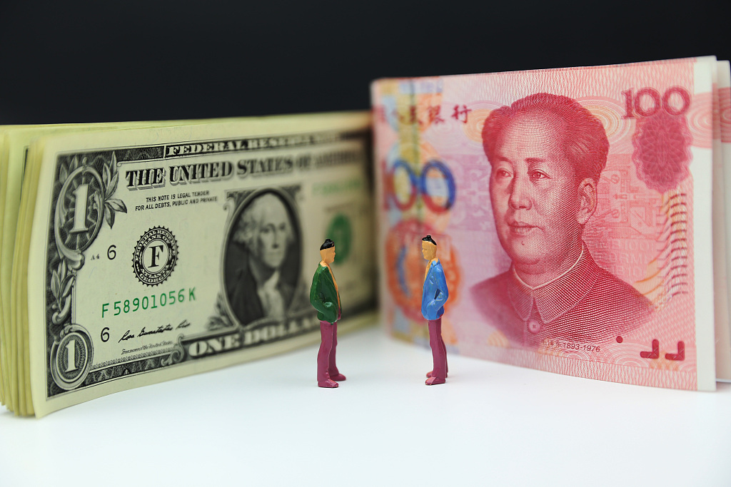 Chinese yuan weakens to 6.9476 against USD Monday
