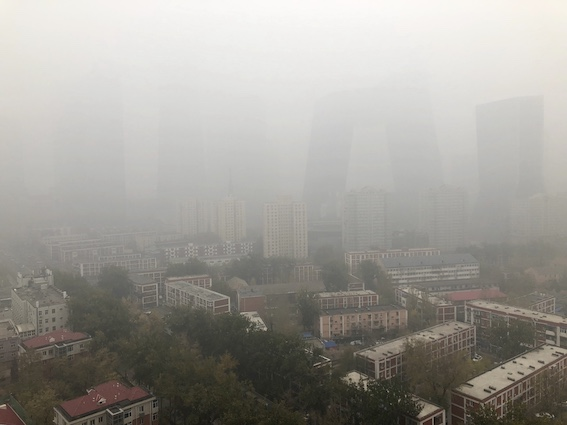 Smog-prone Beijing and surrounding areas issue yellow alert