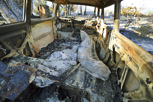 Surfboards are seen inside a destroyed Volkswagen van at a home destroyed by the Woolsey Fire on Dume Drive in the Point Dume area of Malibu in Southern California, Tuesday, Nov. 13, 2018. [Photo: AP]