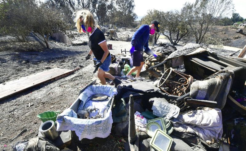 Search on for over 100 missing after California wildfires
