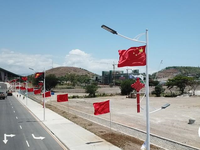 Flags of China, Papua New Guinea fly along Port Moresby's Independence Avenue