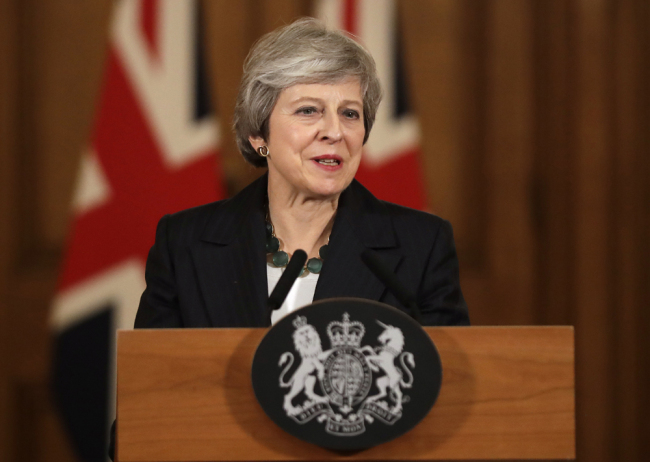 British PM vows to move on with her Brexit plan