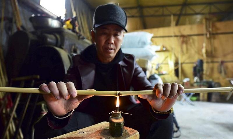 Traditional musical instrument Lusheng maker in China's Guizhou