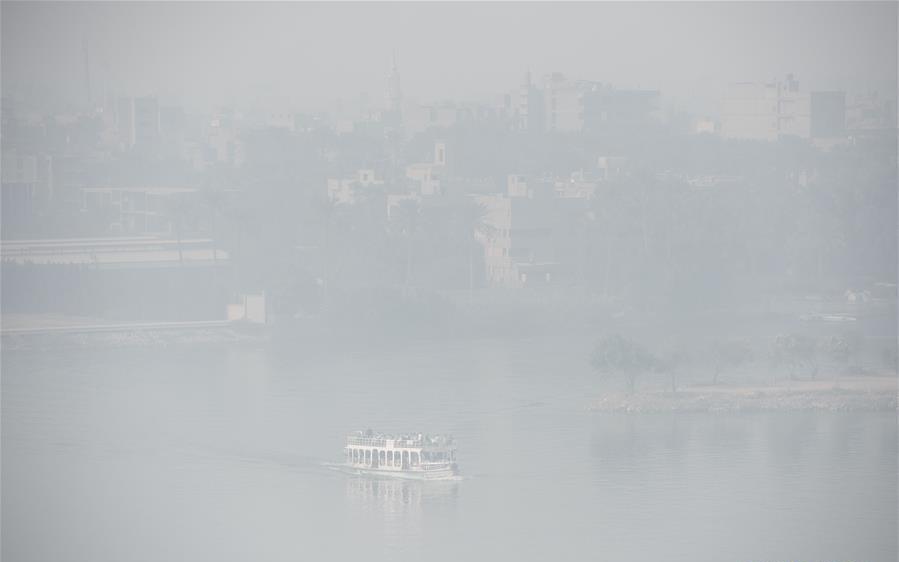 Dense fog blankets Cairo along Nile River