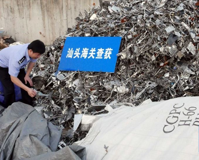 China tightens ban on solid waste imports