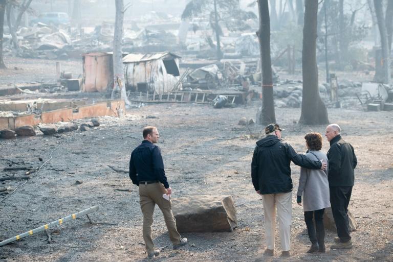 'Sad' Trump visits fire-wracked California, blames mismanagement