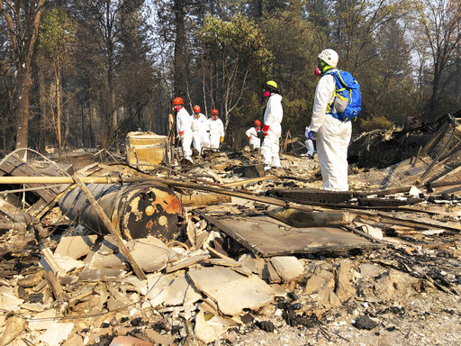 Searchers in California wildfire step up efforts before rain