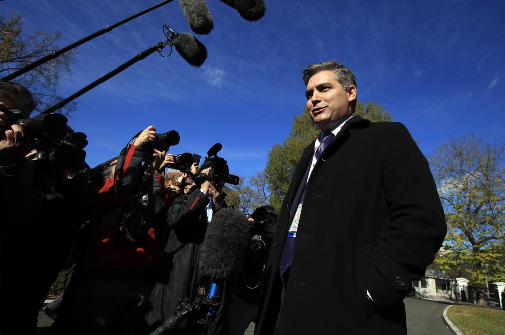 White House to restore Acosta's pass with a warning