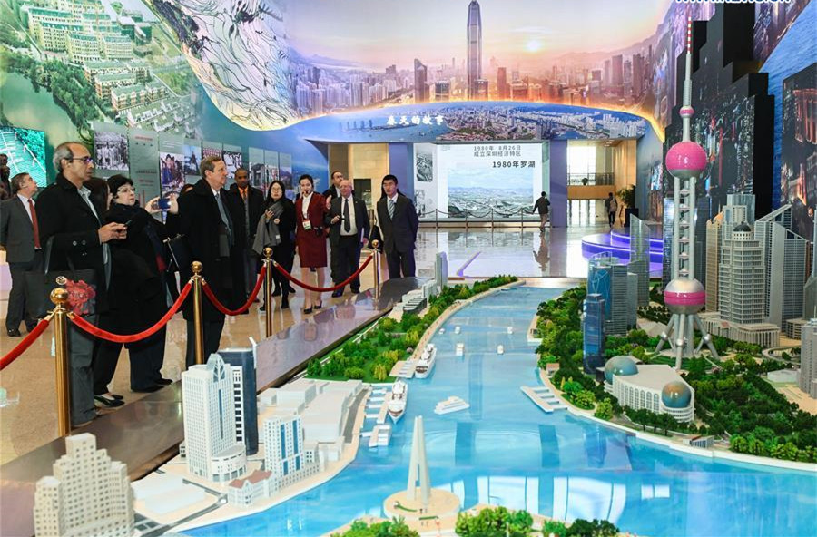 Foreign visitors view exhibition commemorating China's reform and opening-up