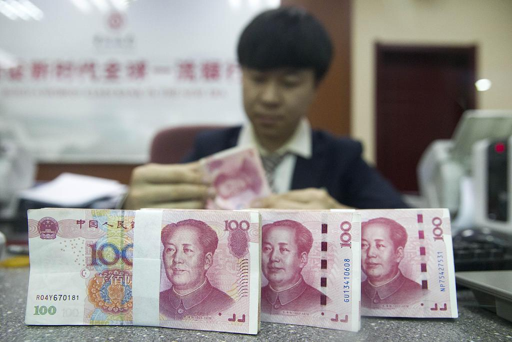 Chinese yuan strengthens to 6.9449 against USD Wednesday