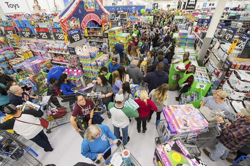 Customers purchase deals from Walmart's Black Friday store event