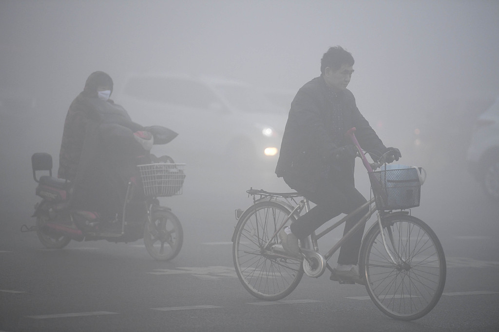 Walking through smog in China