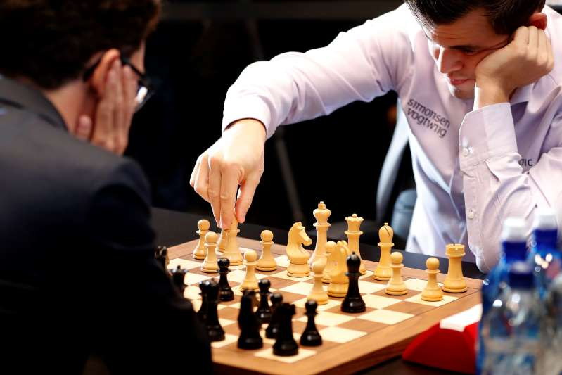 Norway's Carlsen beats Caruana to defend chess world title