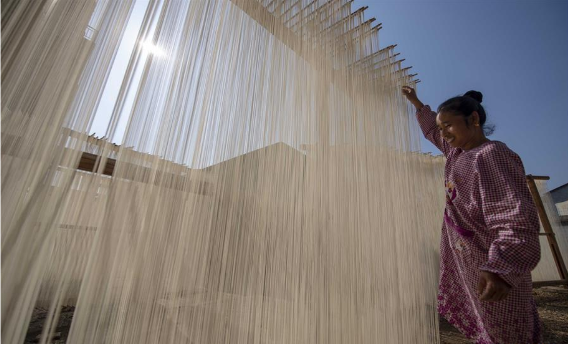 Villagers dry noodles in Xinyu City of east China's Jiangxi