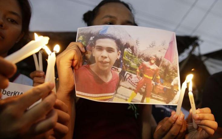 3 Filipino policemen convicted of murder in brutal drug war