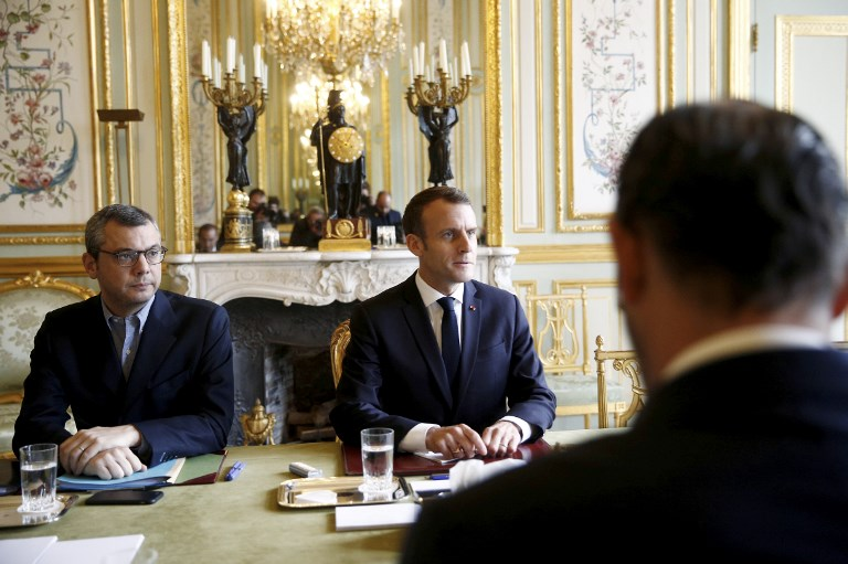 Macron leads crisis meeting after anti-government riots