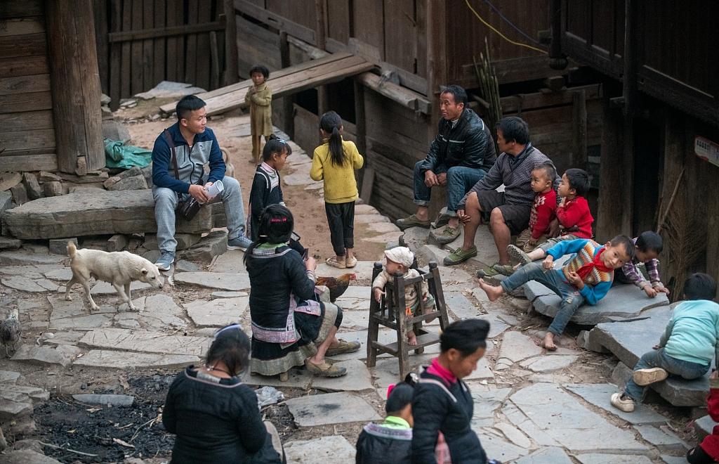 Night school volunteer teacher in rural village SW China