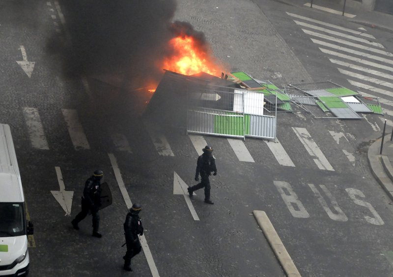 French police fire tear gas in Paris to halt angry protests