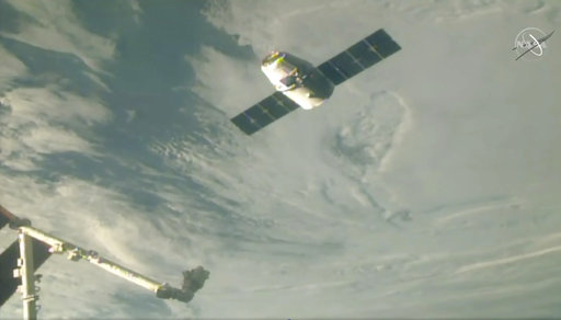 In this image taken from NASA Television, the SpaceX Dragon cargo spacecraft approaches the robotic arm for docking to the International Space Station, Saturday, Dec. 8, 2018. A communication drop-out has delayed a Christmas delivery at the International Space Station. [Photo: AP/ NASA TV]
