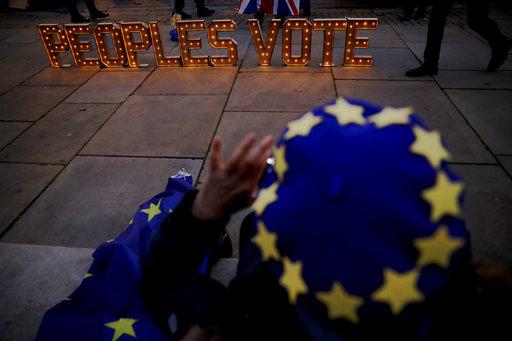 Theresa May postpones vote on Brexit deal