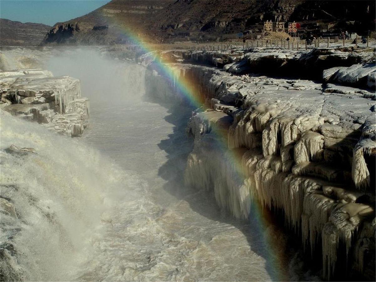 Rainbow over Hukou Waterfall of Yellow River