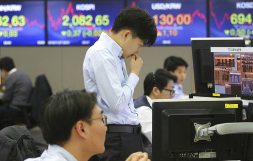 Asian markets sink as profit-takers move in, pound resilient