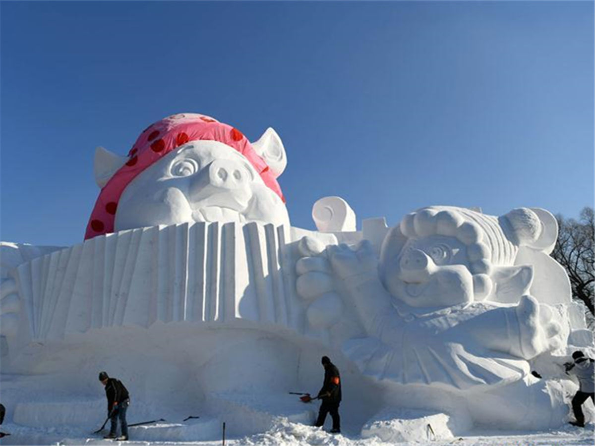 Snow sculpture with 'happy pigs' theme in Harbin, NE China