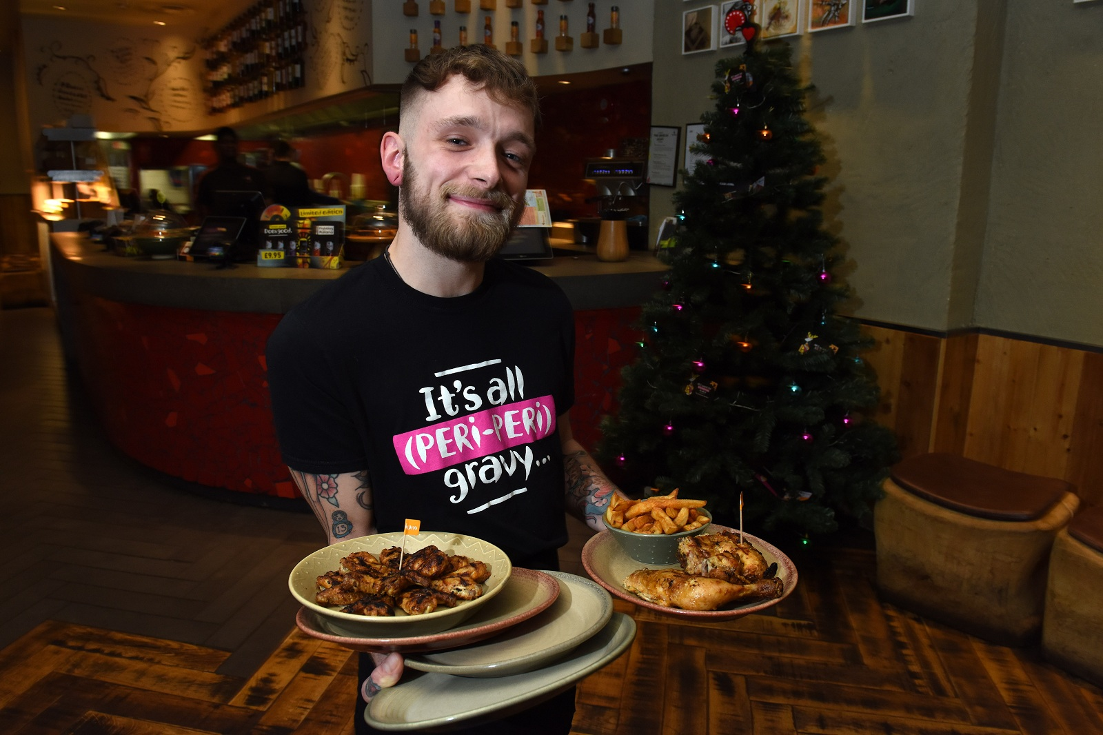 One-handed English young man excels as waiter