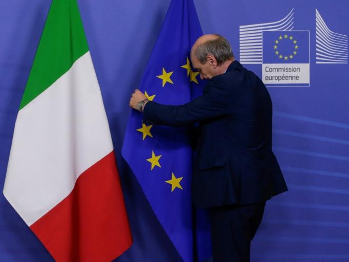 Italy backs down in EU budget truce