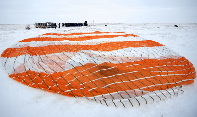 Serena Aunon-Chancellor of NASA is helped out of the Soyuz MS-09 spacecraft just minutes after she, Alexander Gerst of ESA (European Space Agency), and Sergey Prokopyev of Roscosmos, landed in a remote area near the town of Zhezkazgan, Kazakhstan on Thursday, Dec. 20, 2018. [Photo: NASA via AP/Bill Ingalls]