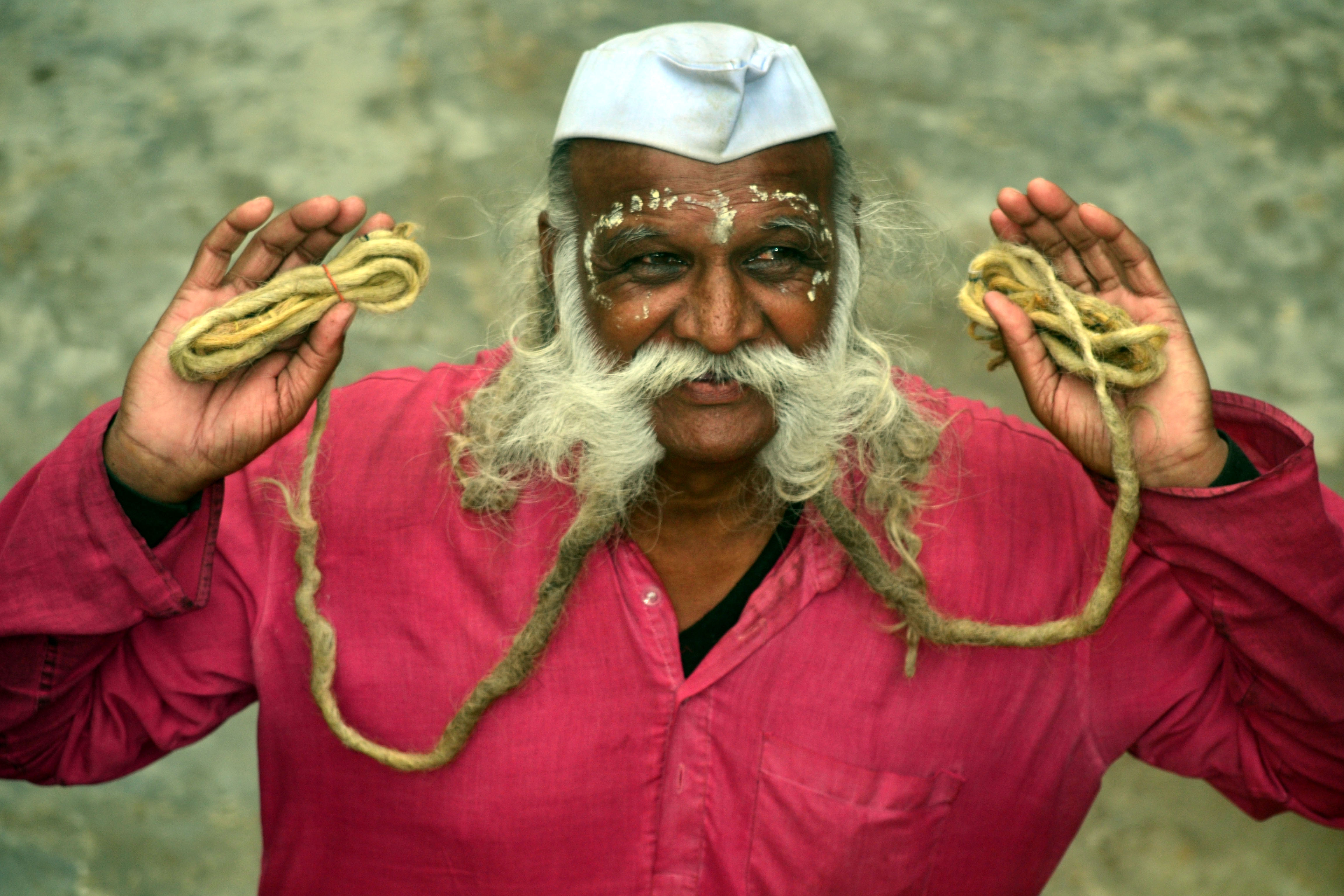 Seventy-year-old Indian man with a 18-foot-long mustache
