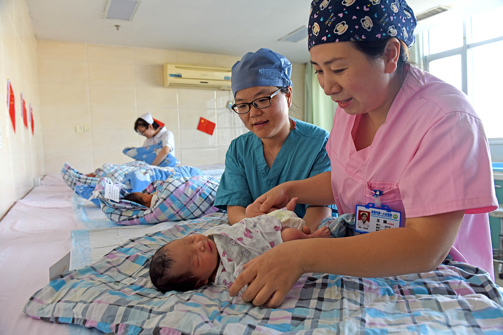 Top legislature to review report on combining maternity, basic medical insurance
