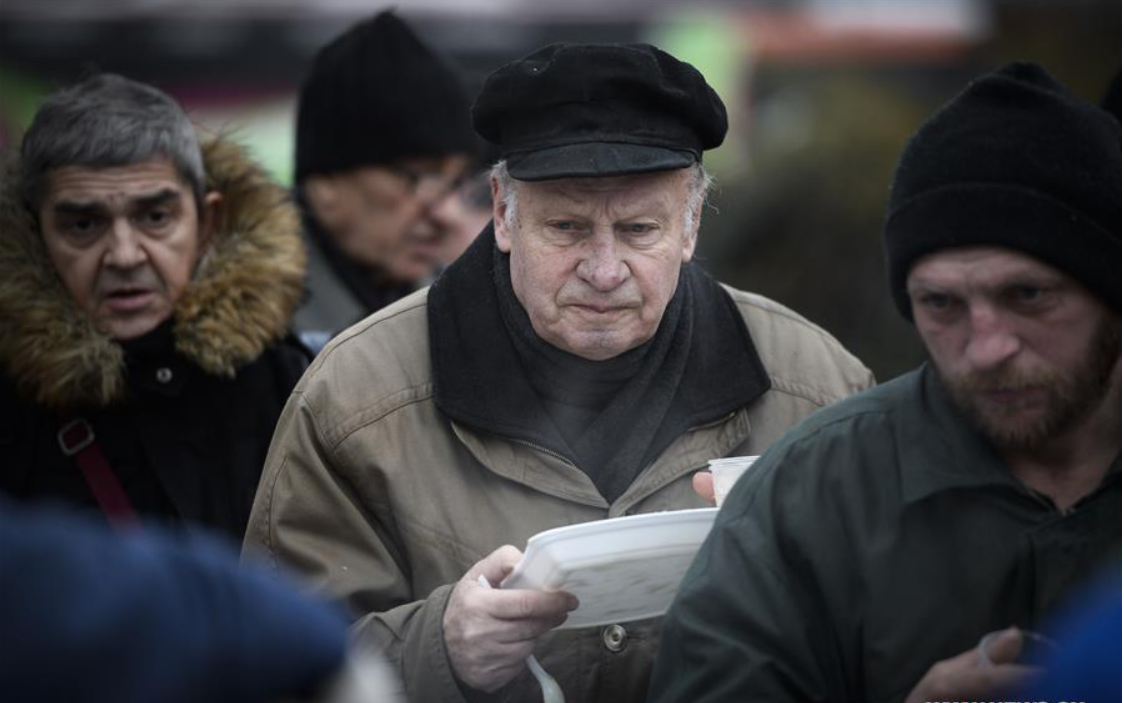 Charity organisations organise free, warm food and clothing for homeless in Warsaw